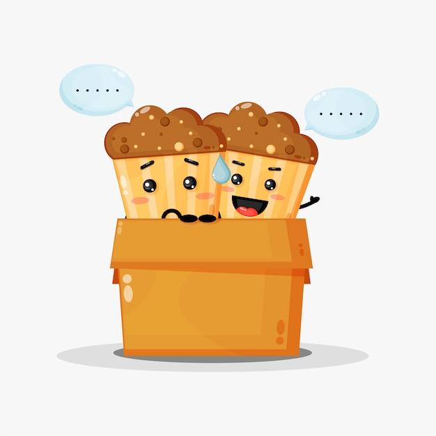 Mascote de muffins fofos na caixa