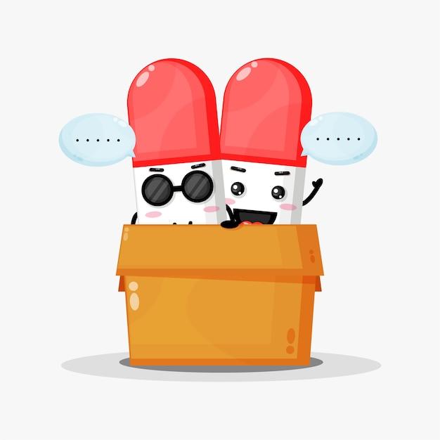 Mascote de pílula fofa na caixa