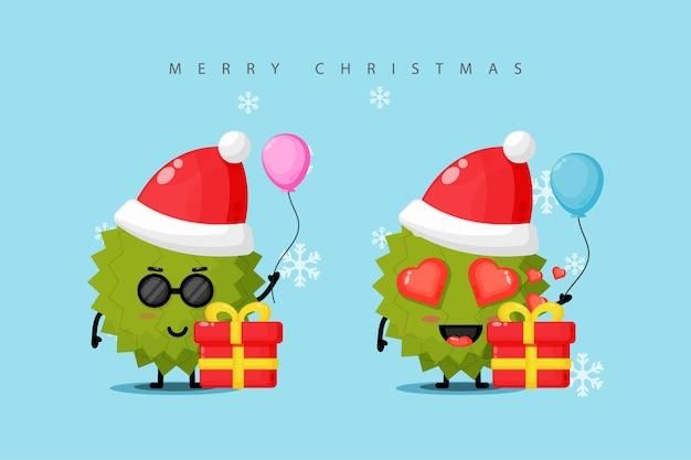 Mascote durian fofo comemorando o dia de natal