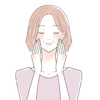 Massagem facial de mulher de meia-idade. sobre um fundo branco.