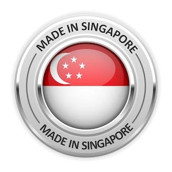 Medalha de prata feita em singapura com bandeira