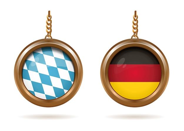 Medalhões de ouro com a bandeira da baviera e da alemanha dentro. bandeira quadriculada azul-branca da baviera e tricolor alemã.