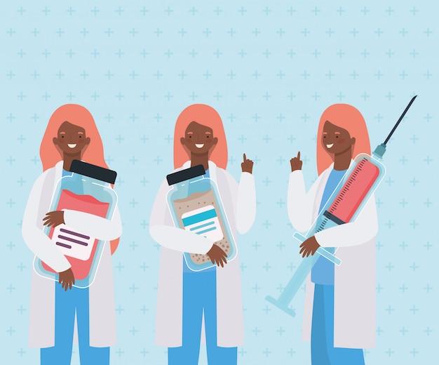 Médicas com frascos de injeção e medicamento