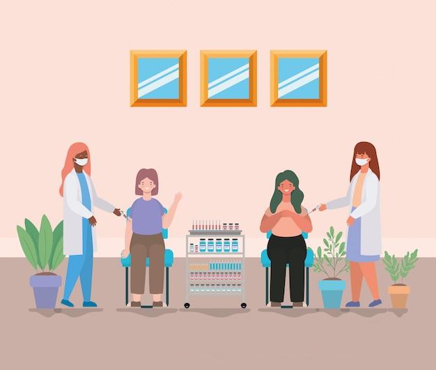 Médicas vacinando mulheres