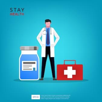 Médico com garrafa de medicamento e ilustração de caixa de primeiros socorros