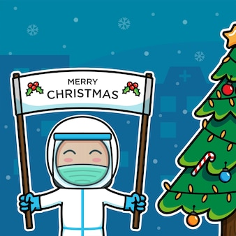 Médico com roupa de proteção carregando o feliz natal