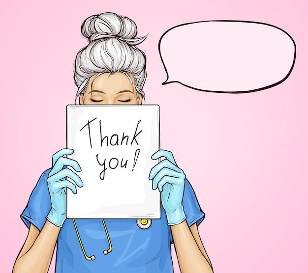 Médico detém cartaz com o texto obrigado
