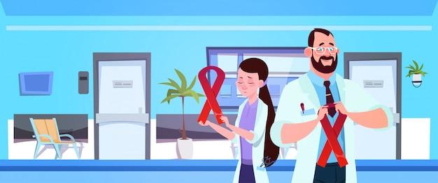Médico, equipe, segurando, vermelho, câncer, fitas