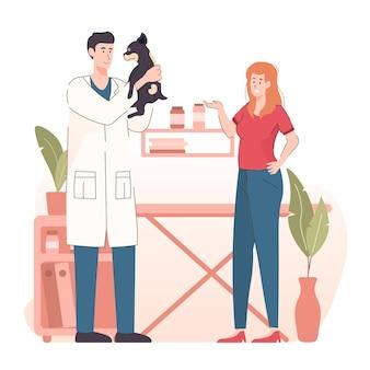 Médico veterinário abraçando um cachorro na clínica veterinária.