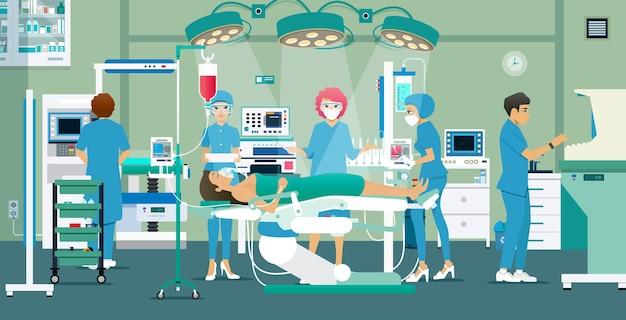 Médicos e enfermeiras tratavam de um paciente na sala de cirurgia.