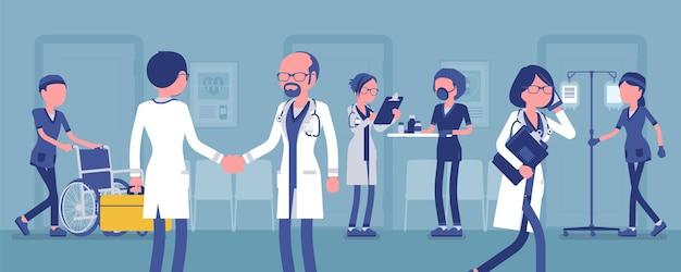 Médicos, enfermeiras trabalhando em um hospital