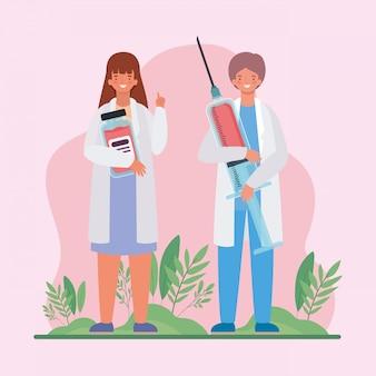 Médicos femininos e masculinos com frasco de medicamento e injeção