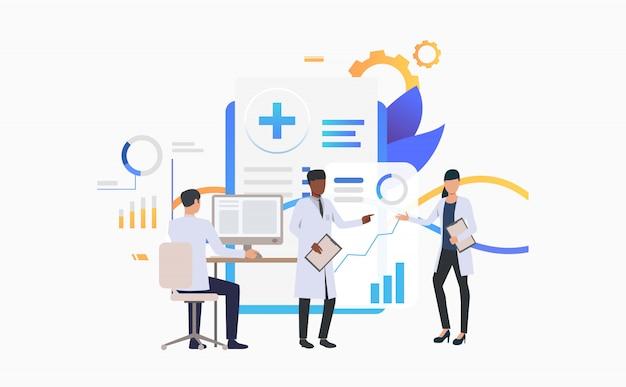 Médicos trabalhando em gráficos