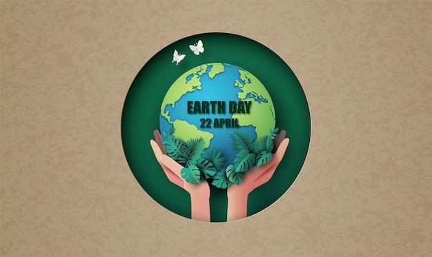 Meio ambiente mundial e conceito do dia da terra com mão e estilo de corte de papel global