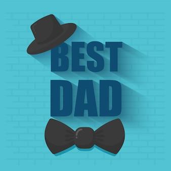 Melhor texto de pai com chapéu fedora e gravata borboleta no fundo da parede de tijolo azul.