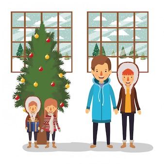 Membros da família comemorando o natal com pinheiro