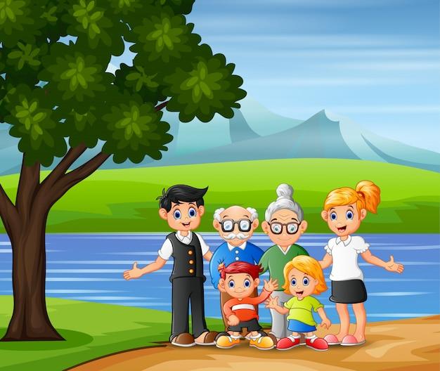 Membros da família em pé na margem do rio