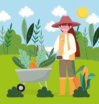 Menina agricultora com cenouras