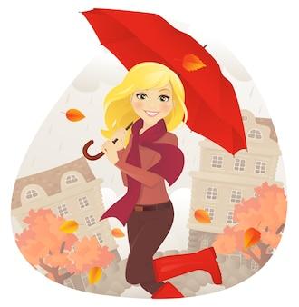 Menina alegre com guarda-chuva na rua de outono