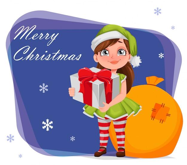 Menina alegre em traje de elfo segurando a caixa de presente