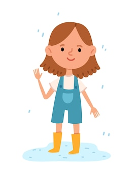 Menina alegre parada em uma poça com botas de borracha