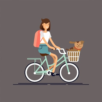 Menina anda de bicicleta com cachorro
