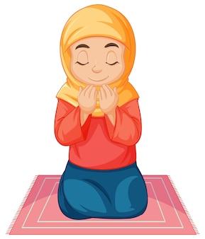 Menina árabe muçulmana em roupas tradicionais rezando e sentada, isolada no branco