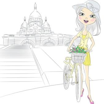 Menina bonita da moda com uma cesta de flores em uma bicicleta em frente ao sacre coeur em paris