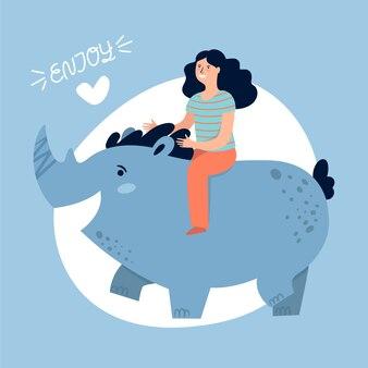 Menina bonita e rinoceronte