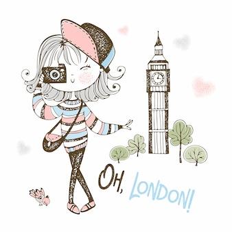 Menina bonita turista com uma câmera em londres.