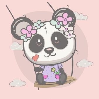 Menina bonitinha balançando panda