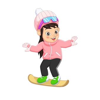 Menina bonitinha com roupas de inverno jogando snowboard