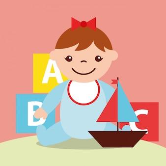 Menina bonitinha e veleiro e blocos de brinquedos do alfabeto
