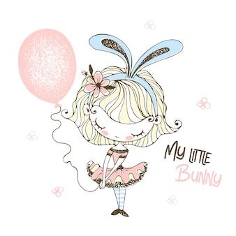 Menina bonitinha em orelhas de coelho com um balão.