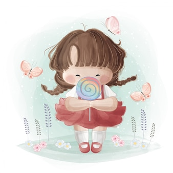 Menina bonitinha segurando um pirulito de arco-íris