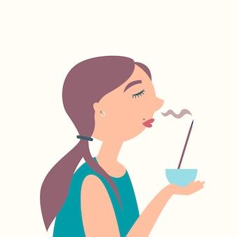 Menina cheirando incenso