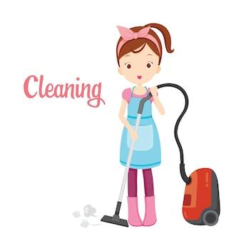 Menina com aspirador de pó, equipamento de limpeza de piso