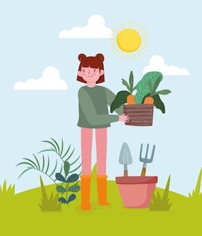 Menina com cenouras e ferramentas
