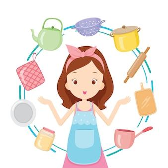 Menina com equipamentos de cozinha, utensílios de cozinha, louças