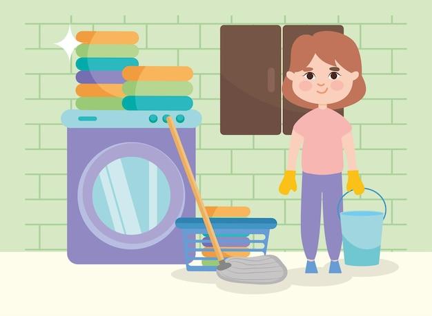 Menina com esfregão e lavanderia na sala de limpeza