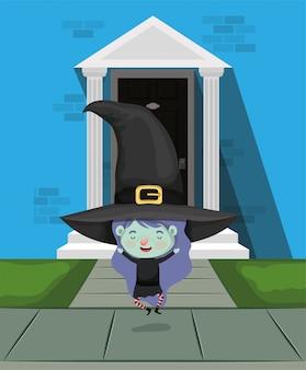 Menina com fantasia de bruxa na porta da casa