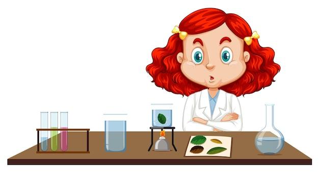 Menina com vestido de ciência sentada à mesa