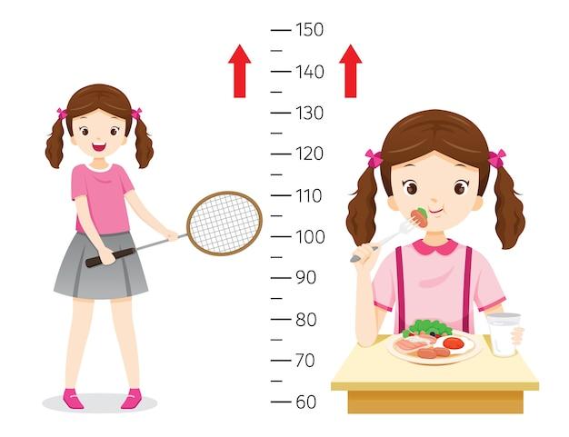 Menina comendo comida e praticando esportes para a saúde e mais alto. menina que mede sua altura.