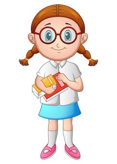 Menina da escola com segurando um livro