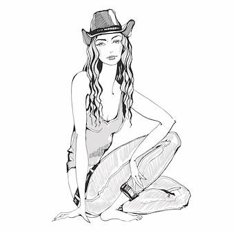 Menina da moda em jeans e chapéu