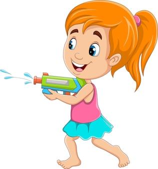 Menina de desenho animado jogando arma de água