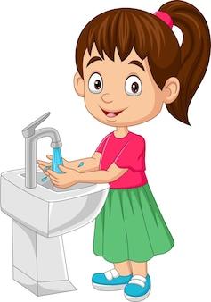 Menina de desenho animado lavando as mãos