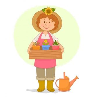 Menina de jardineiro segurando uma caixa de mudas