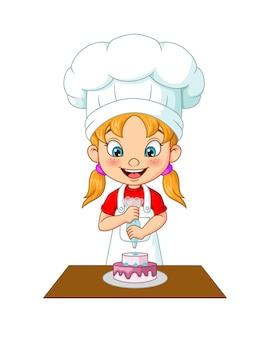 Menina decorando bolo de desenho animado