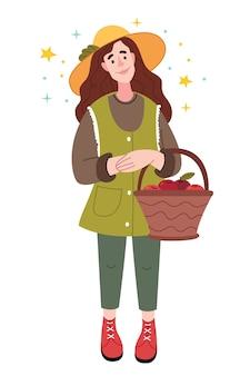 Menina do agricultor segurando uma cesta com maçãs.